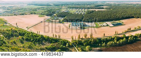Aerial View Granary, Grain-drying Complex, Commercial Grain Or Seed Silos In Sunny Spring Rural Land