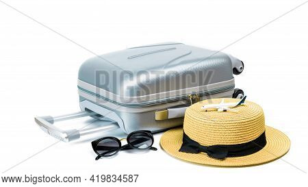 Travel Suitcase Isolated. Travel Accessories With Suitcase, Straw Hat, Toy Airplane In Minimal Trip
