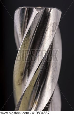 Electric Hammer Drill Bevel Gear Thread Close Up. Mechanism Detail Made Of Steel.