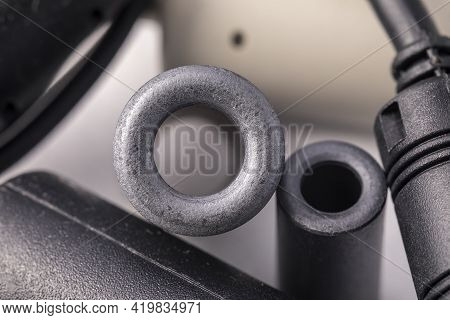 Close Up Of A Ferrite Bead Inductor. An Electrical Element That Suppresses High-frequency Electronic