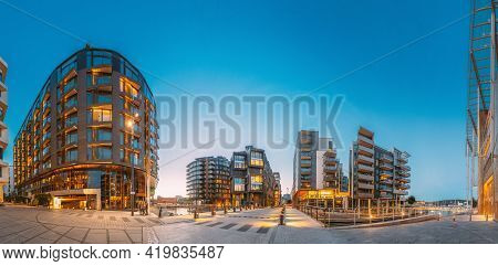 Oslo, Norway. Night View Of Residential Multi-storey Houses In Aker Brygge District. Summer Evening.