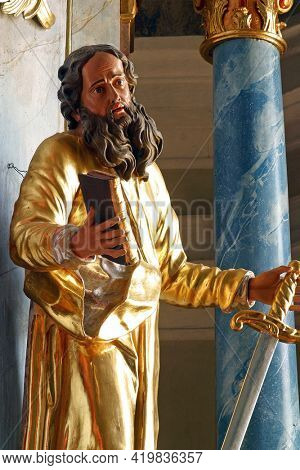 PLESIVICA, CROATIA - JULY 22, 2013: Saint Paul, statue on the high altar at Saint George Parish Church in Plesivica, Croatia