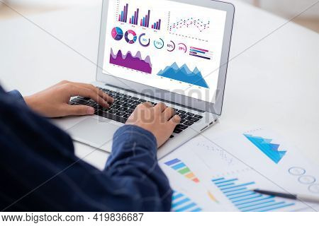 Young Asian Business Man Working Laptop Computer Blank Display Screen While Report Graph And Chart P
