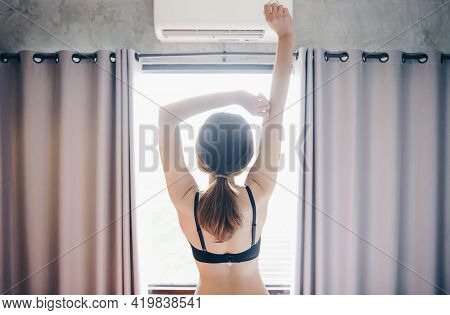 Back View Of Woman Wearing Black Lingerie, Raised Her Arms For Stretching Nearly Window After Waking
