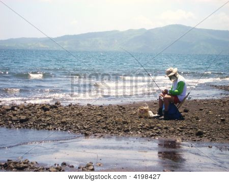 Fisherman With Two Rods