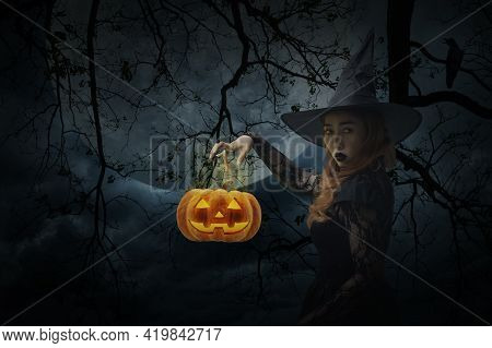 Halloween Witch With Pumpkin Monster Head Standing Over Dead Tree, Crow, Birds, Full Moon And Spooky