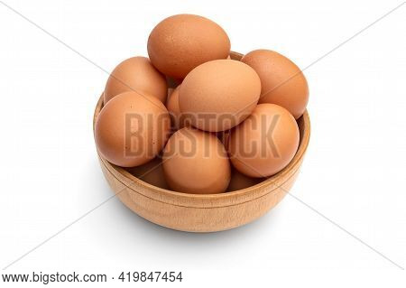 Wooden Bowl With Eggs On A White.