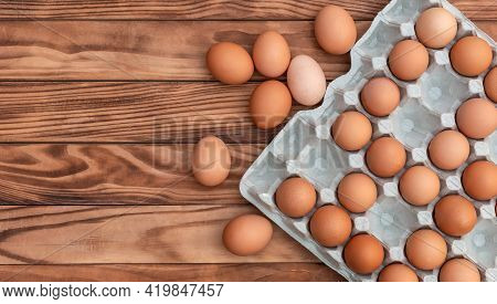 Eggs Tray On Wooden Background. Copy Space.