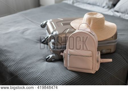 Modern Suitcase Full Of Things, Handbag And Straw Hat. Baggage Case Packing Getting Ready To Travel