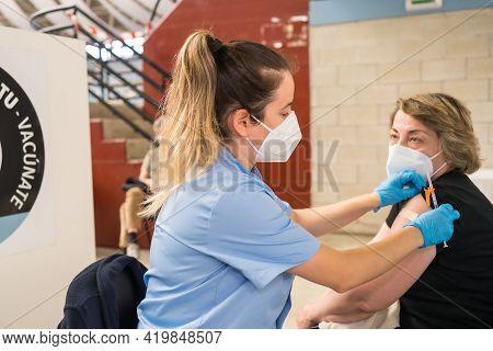 San Sebastián, Gipuzkoa. Spain. May 8, 2021: A Lady Entering The Vaccination, Vaccination And Total