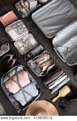 Organization Of Storage Carrying Necessary Things In Comfortable Case With Konmari Method On Bed