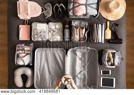 Top View Woman Hands Getting Ready To Travel Vacation Packing Suitcase Use Konmari Method
