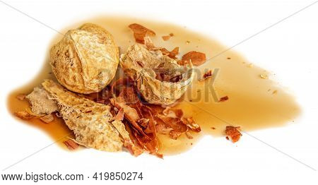 Peanuts And Caramel Pouring Isolated On White Background. Melted Sugar Caramel Sauce With Crushed Nu