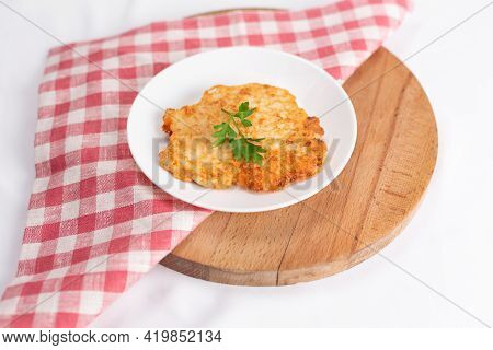 Meat In Batter Garnished With Parsley On A White Background