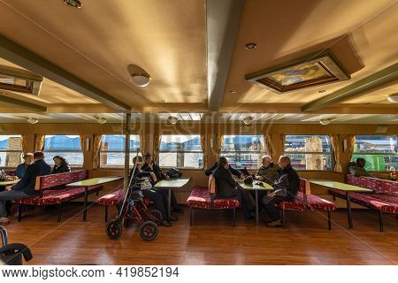Prien Am Chiemsee, Germany - 15 December 2019 - Tourists Wait On The Charter Boat To Visit The Herre