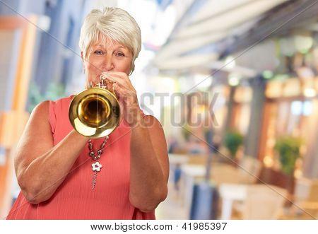 Mature Woman Blowing Her Trumpet, Indoor