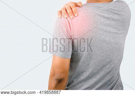 Man Holding The Shoulder Have Back And Shoulder Pain
