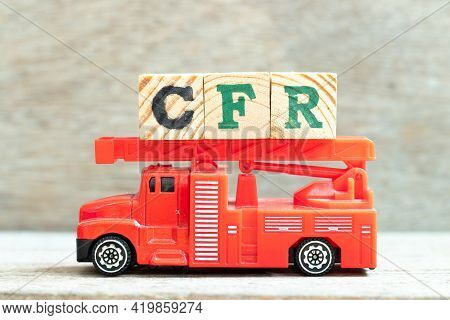 Fire Ladder Truck Hold Letter Block In Word Cfr (abbreviation Cost And Freight) On Wood Background