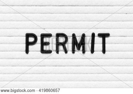 Black Alphabet Letter In Word Permit On White Felt Board Background