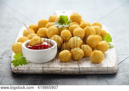 Crispy Potato Balls With Ketchup On White Wooden Board