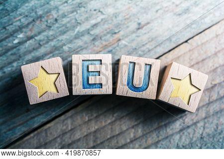 Eu European Union With 2 Stars Written On Wooden Blocks On A Board