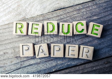 Reduce Paper Written On Wooden Blocks On A Board - Save Trees Concept