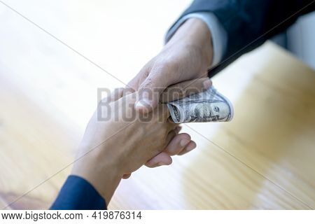 A Businessman Or Official Is Accepting Money Handed Over