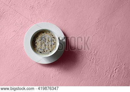 Black Coffee In A Porcelain Cup On A Pink Concrete Surface. Minimalism. Copy Space