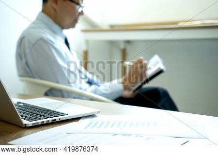 Smart Businessman Sitting Happily Thinking On A Chair