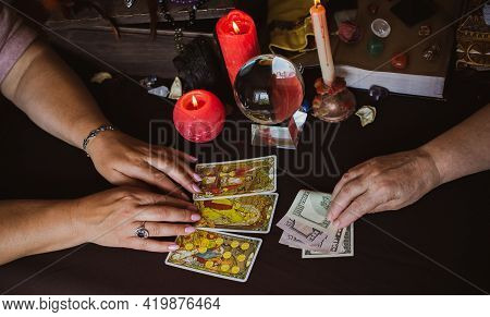 Seance Of Magic Wish A Money, Fortune Telling On A Tarot Cards, Candles And Fortune-telling Objects.