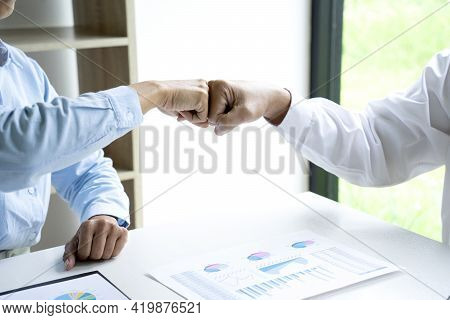 Two Business People Use Hand To Fist Bump For Succes Teamwork