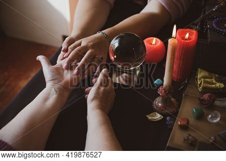 Palm Rider - Seance Of Fortune Telling On A Hand, Candles And Fortune-telling Witch Objects. The Con