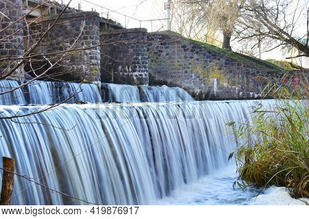 River Dam. Water Release, The Excess Capacity Of The Dam Until Spring-way Overflows. Streams Of Wate