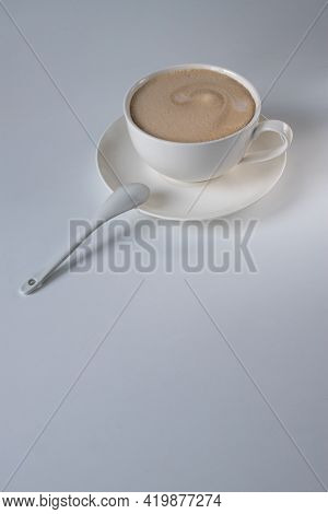 Americano Coffee With Milk In A White Cup And Saucer On The Table. Morning Coffee