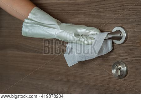 Actions To Prevent The Spread Of Coronavirus Covid-19, Disinfection Of The Door Handle. Hand In Whit