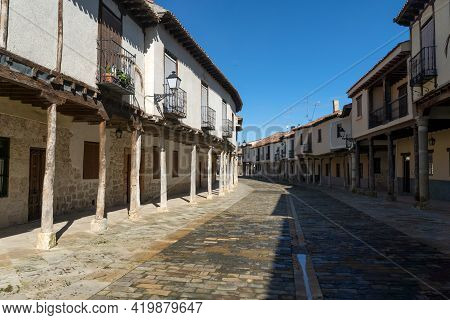 Ampudia, Spain - February 23, 2021: Streets With A Traditional Castilian Architecture With Its House