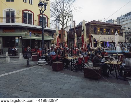 Thessaloniki, Greece - May 07 2021: Bar Restaurants Open For The Summer. Crowd Sitting Without Face