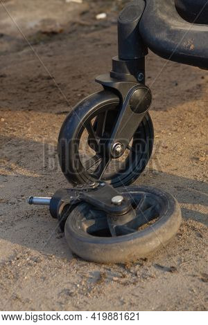Old Broken And New Pram Wheel, Pram Wheel Replacement.