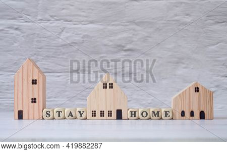 Stay Home Small Wooden House And Square Block Of Wood On A White Wooden Table. Real Estate Trading C