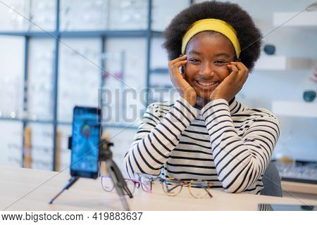 Smiling Pretty African Teen Girl Blogging Online And Streaming Live. African Teenage Girl Use Social