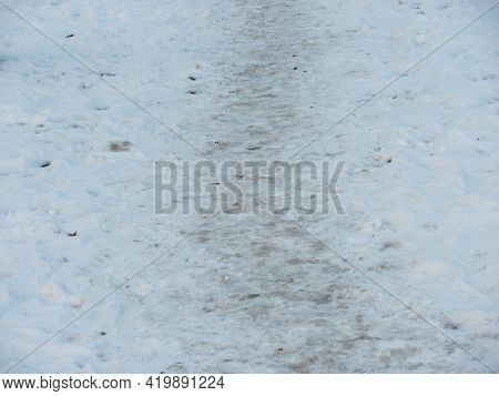 A Path In The Muddy Spring Snow