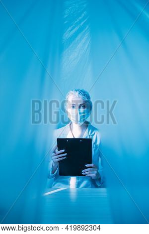 Medical Record. Hospital Admission. Pandemic Healthcare. Female Doctor In Ppe Protective Face Mask W