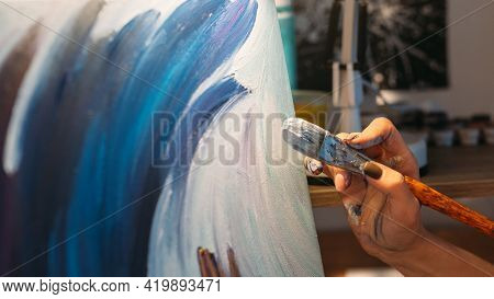 Visual Art. Painting Hobby. Talent Imagination. Female Painter Hand Creating Blue White Contemporary