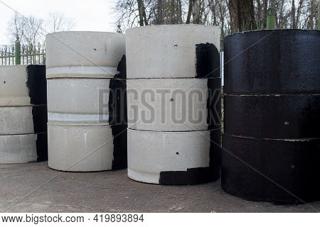 Reinforced Concrete Rings For The Construction Of Sewers And Wells, Outside. Gray And Tarred.