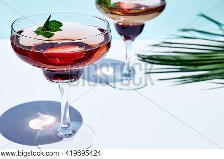 Fresh Summer Strawberry Cocktail Or Mocktail On The Table In The Garden. Creative Drink Beverage On