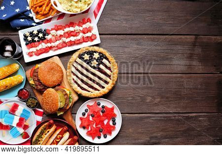 Fourth Of July, Patriotic, American Themed Food. Top View Side Border On A Dark Wood Background. Cop