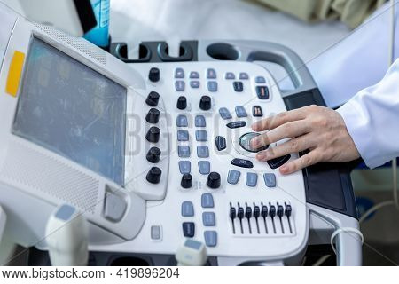 Doctor Hand At Ultrasound Scanner Control Panel. Ultrasound Machine Doctor Hand Use Investigation. D