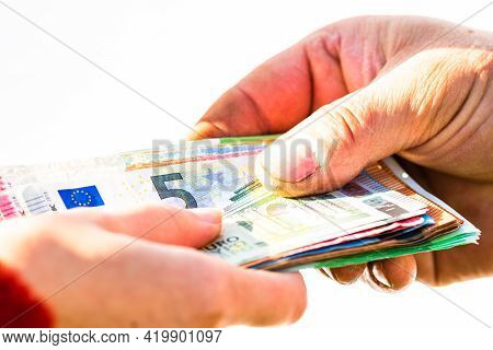 Hand Giving Stack Of Money Isolated, Hard Worked Hand Taking Euro Money. Currency Transfer On White