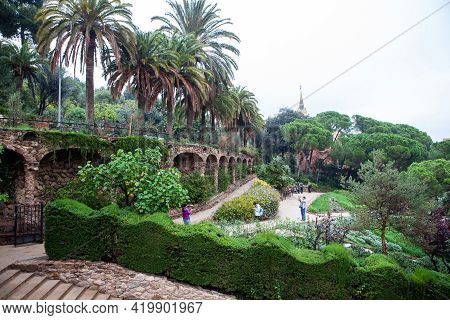 Barcelona, Spain - October 27, 2015: Tourists In The Park Guell, A Public Park Designed By Architect