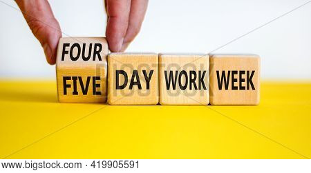 4 Or 5 Day Work Week Symbol. Businessman Turns The Cube, Changes Words 'five Day Work Week' To 'four